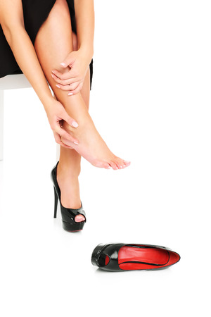 A picture of female feet in pain after wearing high heeled shoes