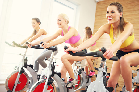 Photo pour Picture of sporty group of women on spinning class - image libre de droit