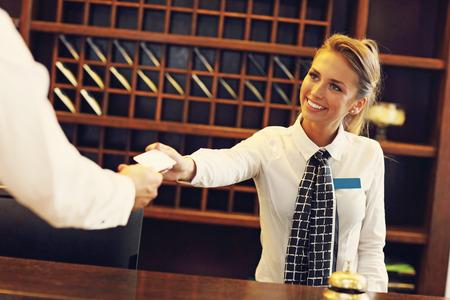 Photo pour Picture of receptionist giving key card - image libre de droit