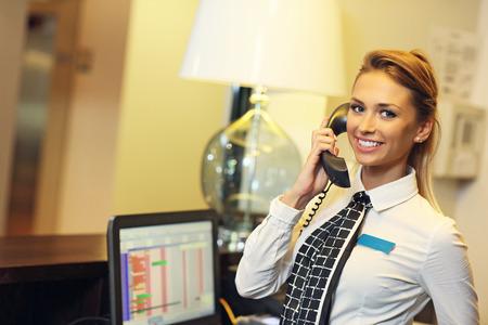 Photo pour Picture of pretty receptionist at work - image libre de droit