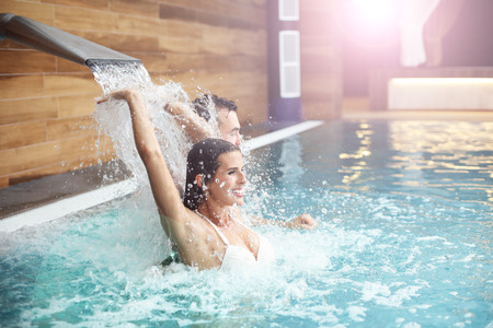 Photo pour Picture of happy couple relaxing in pool spa - image libre de droit