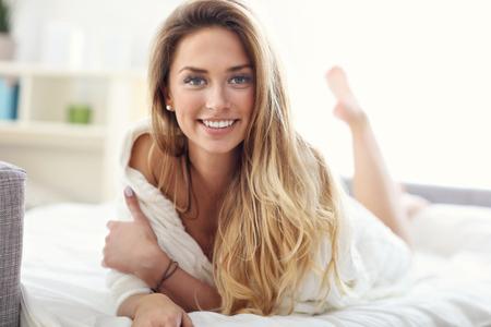 Photo pour Picture showing happy woman relaxing at home - image libre de droit
