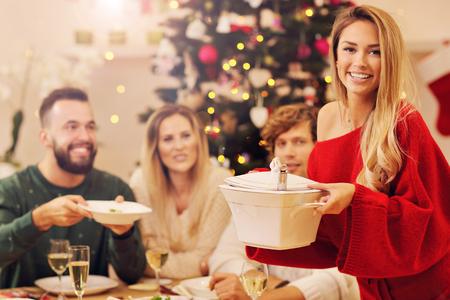 Photo pour Group of family and friends celebrating Christmas dinner - image libre de droit