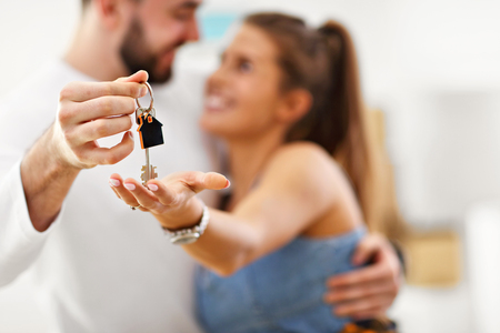 Photo for Picture showing happy adult couple moving out or in to new home - Royalty Free Image