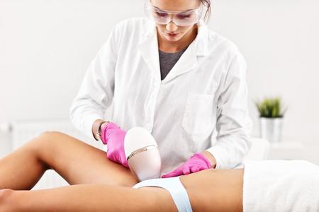 Photo pour Adult woman having laser hair removal in professional beauty salon - image libre de droit