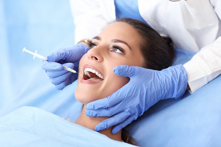 Adult woman having a visit at the dentists