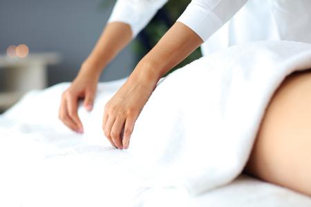 Handsome man having massage in spa salon
