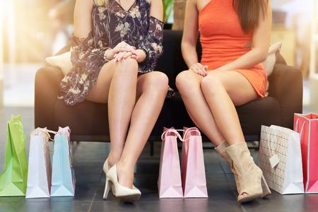 Photo pour Girl friends shopping for clothes in store - image libre de droit