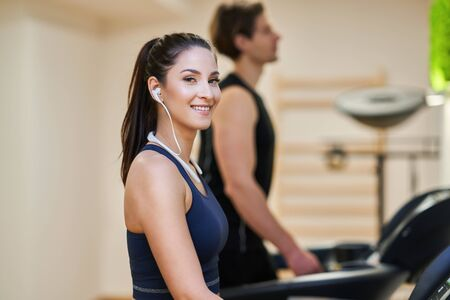 Photo for Fit couple at the gym looking very attractive - Royalty Free Image