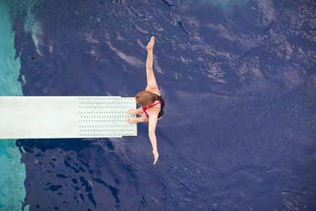 preparing to dive into a swimming pool