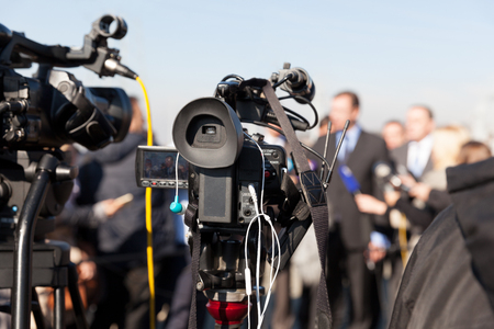 Photo for Press conference. Covering an event with a video camera. - Royalty Free Image