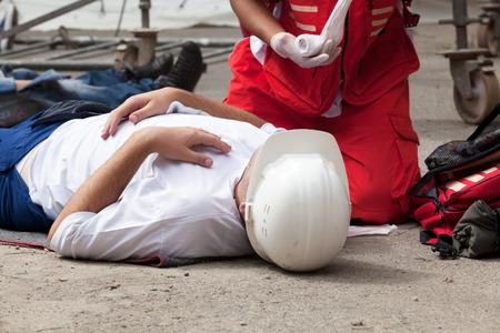 Photo pour Work accident. First aid training. - image libre de droit