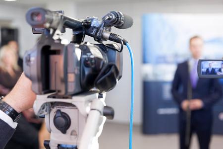 Photo pour Filming media event with a television camera - image libre de droit