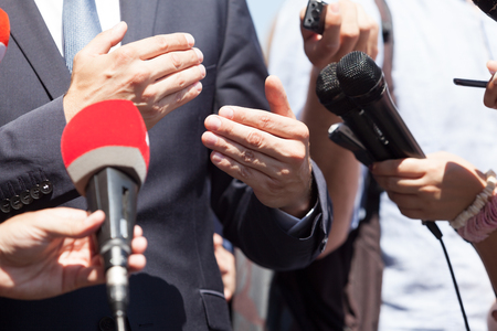 Photo for Businessman or politician gesturing during news conference - Royalty Free Image