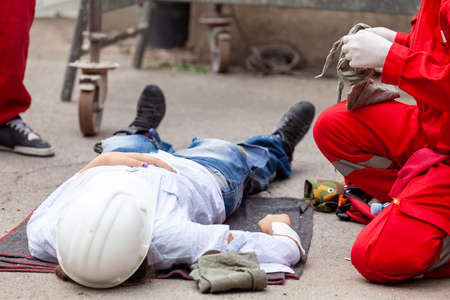 Photo for Work accident or workplace accident at construction site. First aid and CPR training. - Royalty Free Image