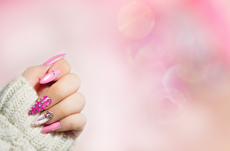 Foto de Colorful  Nail art . Manicure.  Holiday style bright Manicure with gems and sparkles. Nail Polish. Fashion with diamond shine , Trendy Accessories. Beauty hands. Stylish Nails, Nailpolish. - Imagen libre de derechos