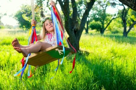 Young girl on swing