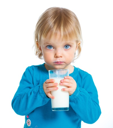 Little girl with a glass of milk on white background