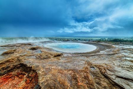 Geothermal hot water at the geysir district in Iceland  Sleeping Stori Geysir