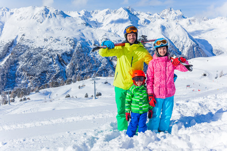 Photo pour Skiing, winter fun - happy family on ski holiday - image libre de droit