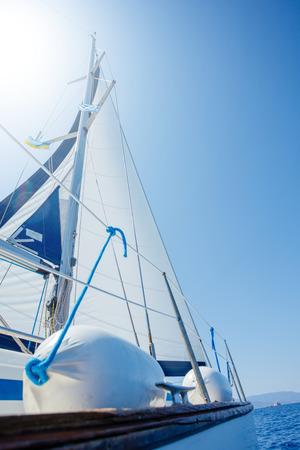 Photo pour Sailing. Ship yachts with white sails in the open Sea. - image libre de droit