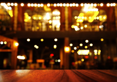 Photo pour top of wood table with lamp light of bar or night club resturant party background - image libre de droit