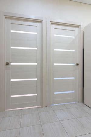 Photo pour Two interior doors in the apartment close up - image libre de droit