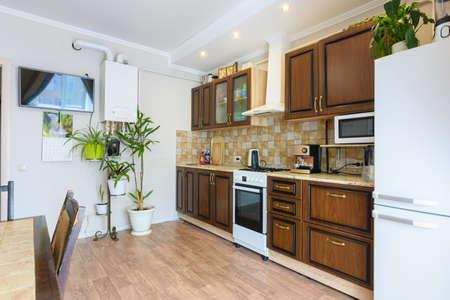 Foto de Kitchen set in a spacious living room and kitchen with an old classic wood design - Imagen libre de derechos