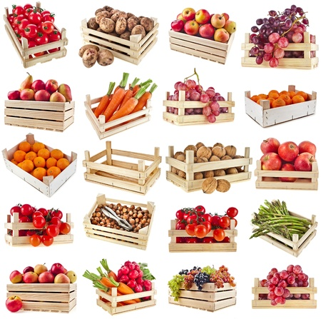 Fresh tasty fruits, vegetables, berries, nuts in a wooden crate box ,collection set isolated on a white backgroundの写真素材