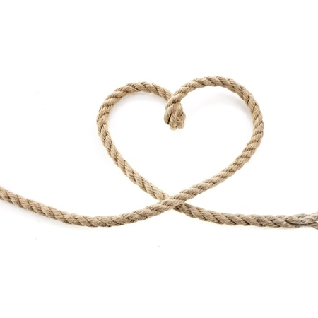 Heart Shaped Knot on a Jute rope isolated on white background