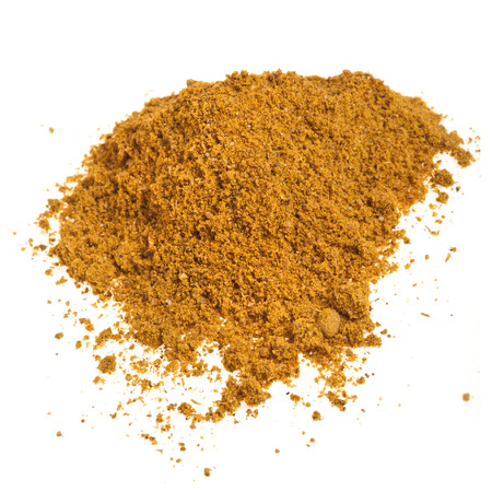 Close-up heap of curry powder spice isolated on white background