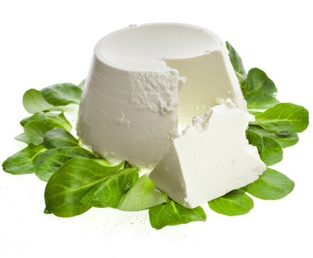 Ricotta Cheese with spinach isolated on white background