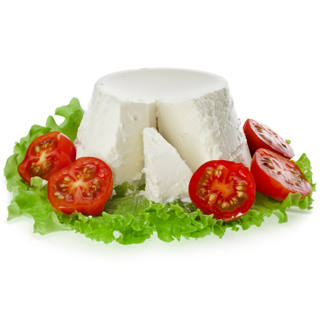 Ricotta Cheese in the lettuce leaves and tomato isolated on white background