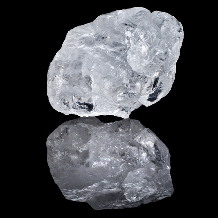 single white transparent Quartz, Rock Crystal with reflection on black surface background