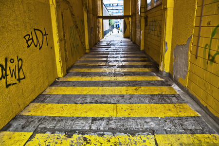 dark alley with yellow stripes in the city of Rotterdam