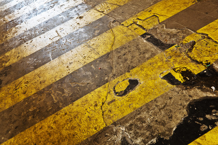 urban alley with yellow zebra crossing