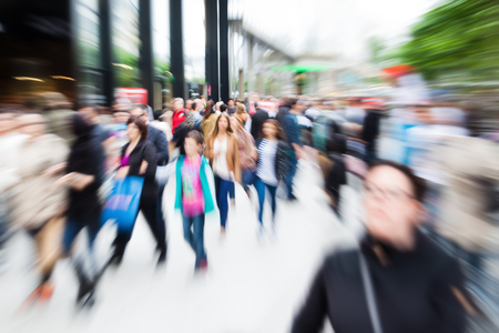 Photo pour crowd of people shopping in the city with zoom effect - image libre de droit