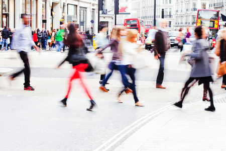 Photo pour shopping people crossing a street in the big city - image libre de droit