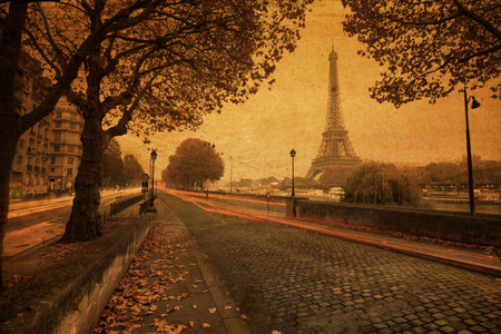 vintage style picture of Paris at dusk with a street along the Seine and the Eiffel Tower in the background