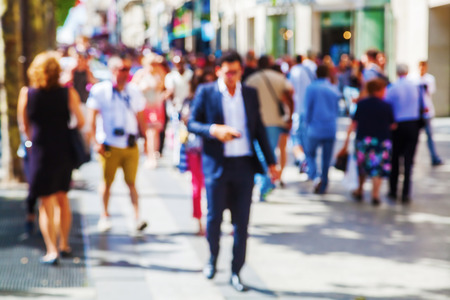 Photo for out of focus picture of a crowd of people walking in the city - Royalty Free Image