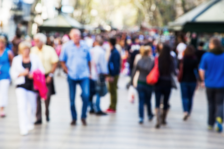 Foto per crowd of people out of focus on a strolling promenade - Immagine Royalty Free