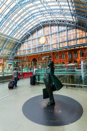 London, UK - June 16, 2016: Sir Betjeman Statue at St. Pancras Station with unidentified people. Sir John Betjeman was responsible for saving the Station and the Chambers from demolition in the 1960s