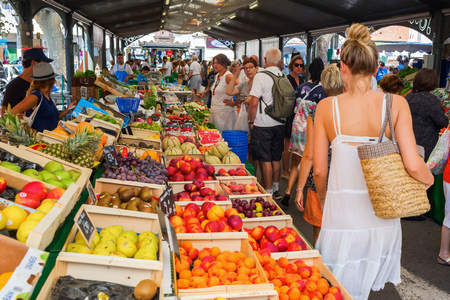 Photo for Cannes, France - August 05, 2016: Provencal market in Cannes with unidentified people. Cannes is well known for its association with the rich and famous, and the Cannes Film Festival - Royalty Free Image