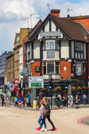 London, UK - June 17, 2016: street scene with historic buildings and unidentified people in Camden. The London Borough of Camden is a borough in north west London, and forms part of Inner London.