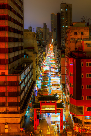 Hong Kong, Hong Kong - March 14, 2017: Temple Street in Kowloon, Hong Kong, at night. It is known for its night market and as one of the busiest flea markets at night in the territory