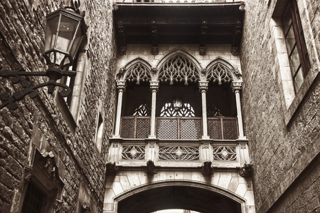 Famous Bridge at Carrer del Bisbe in Gothic Quarter at Bishop Street, Old town of Barcelona, Catalonia, Spain