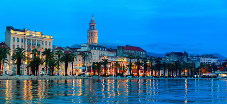 View of Split is the second-largest city of Croatia at night. Shore of the Adriatic Sea and famous Palace of the Emperor Diocletian - archaeological gem and a must-see for everyone