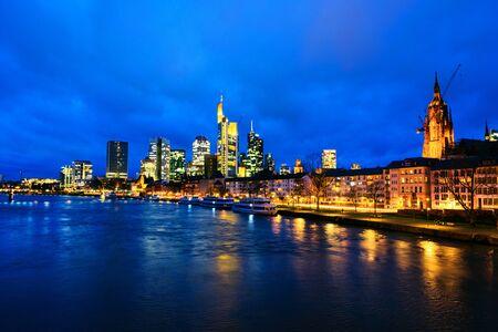 Foto für Skyline of Frankfurt, Germany in the sunset with famous illuminated skyscrapers - Lizenzfreies Bild