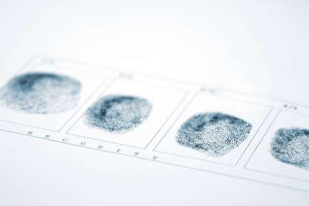 A fingerprint on a white sheet of paper