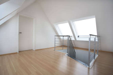 A loft wiht a door and stairs